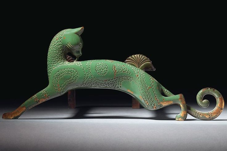 Christie's, Important 20th Century Decorative Art & Design (June 14) Lot 158 Armand Albert Rateau Andirons, circa 1929 A pair of elegant andirons, featuring green-lacquer bronze cats, with handstamped surfaces and wrought-iron rails embellished with bronze palmettes. Estimate: $120,000–$180,000