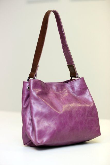 Small plum coloured bag can hold a surprising amount