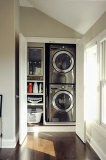 talk about convenience! This metallic stacked washer-dryer unit is tucked away in a closet (4.6 feet wide and 3.7 feet deep) right in the mas...