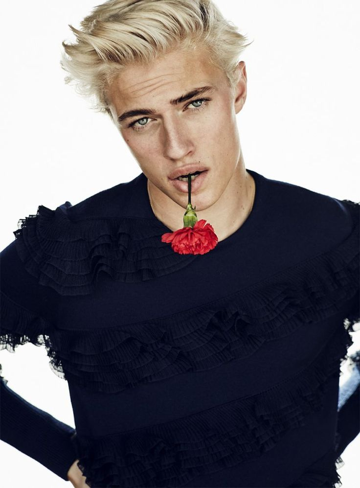 Posing with a rose in his mouth, Lucky Blue Smith wears top Alexander McQueen.