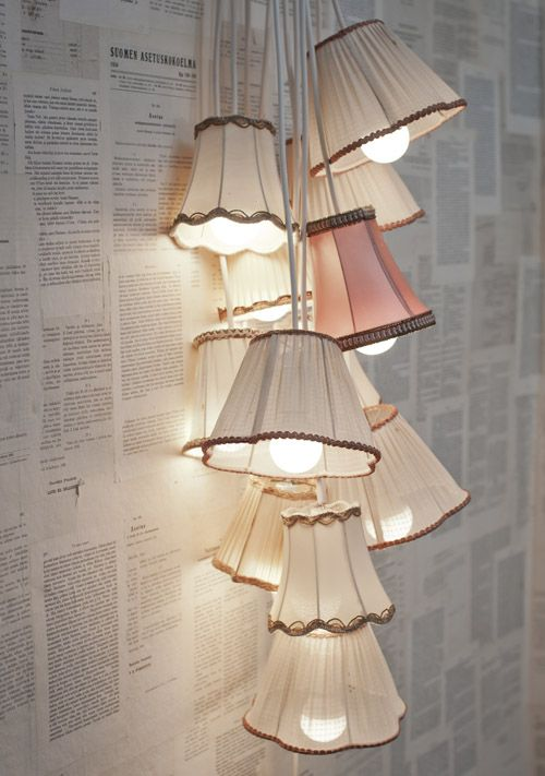 SUCH a cute idea! Have a few extra lampshades laying around? Transform them into a chic light fixture! #Craft..Oh & I Love The Book Pages Used As Wall-Paper Too...xxx