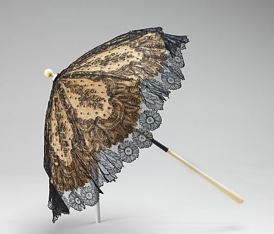 Parasols in this era were often collapsible as this one is (the hinge is inside the black part of the handle). I love the black lace overlay... oh, I'm inspired to go convert my white modern parasol to something that looks like this!