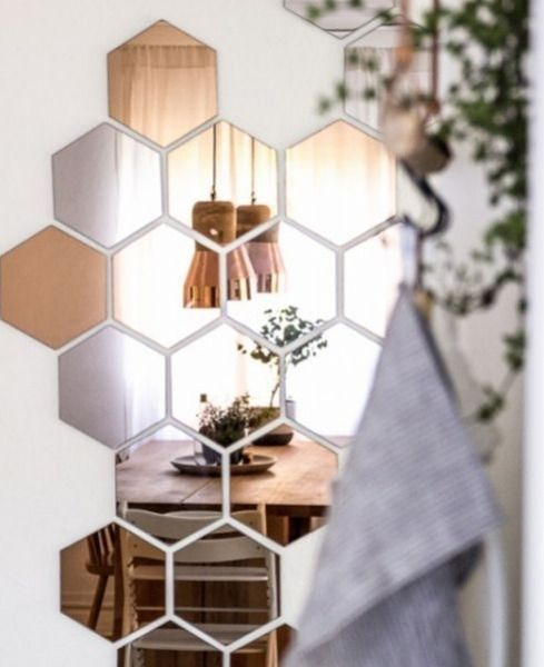 This is less hack and more artful whimsy, but you can really let your creativity fly using the Hönefoss copper hexagon mirrors from Ikea