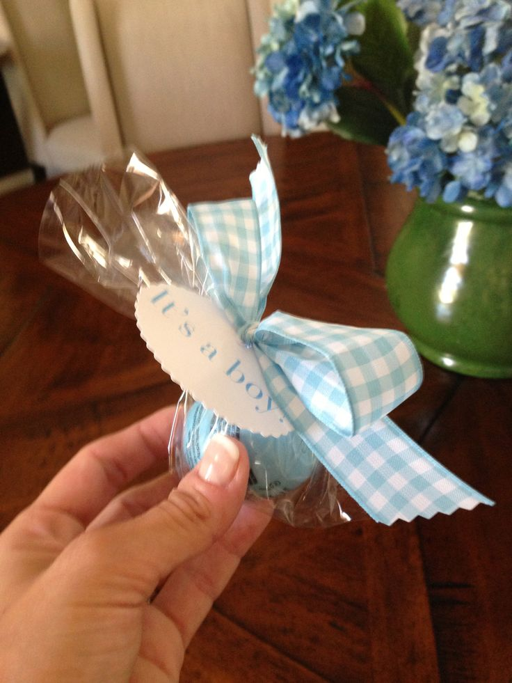 "EOS lip balm wrapped in cellophane with ""It's a Boy!"" gift tag.  Great favor gift for a shower for a baby boy."