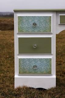 Hannah Beth: refurbished furniture. I like the alternating drawer design.