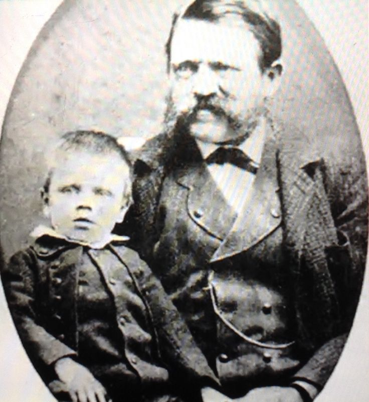 Young Adolf and his stern father Alois.