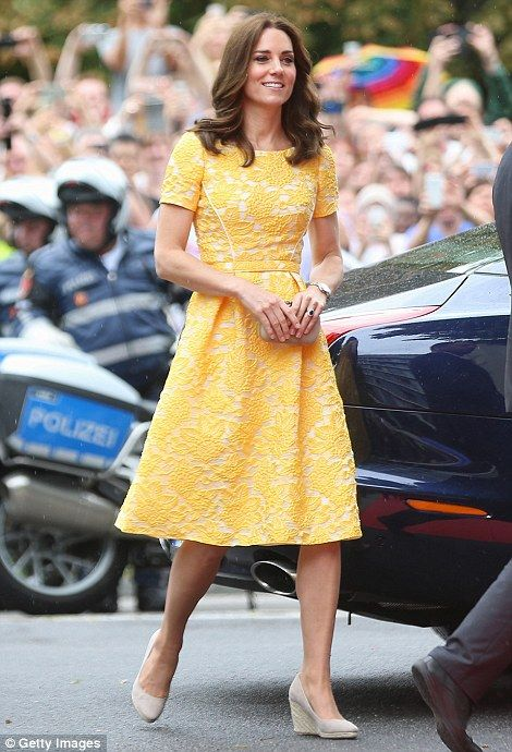 It was a rainy morning in Heidelberg, but Kate added a splash of colour to proceedings in a yellow lace dress by Jenny Packham