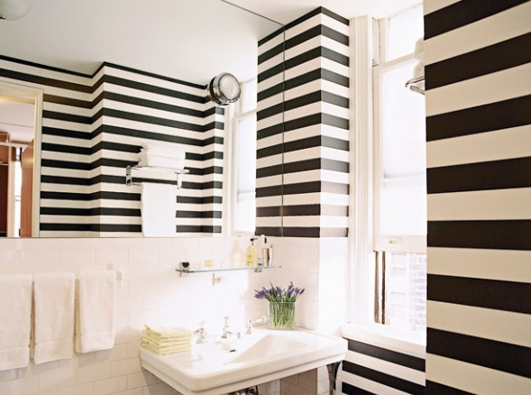 The graphic pattern of Clarence House's Large Stripe wallpaper was hung horizontally.