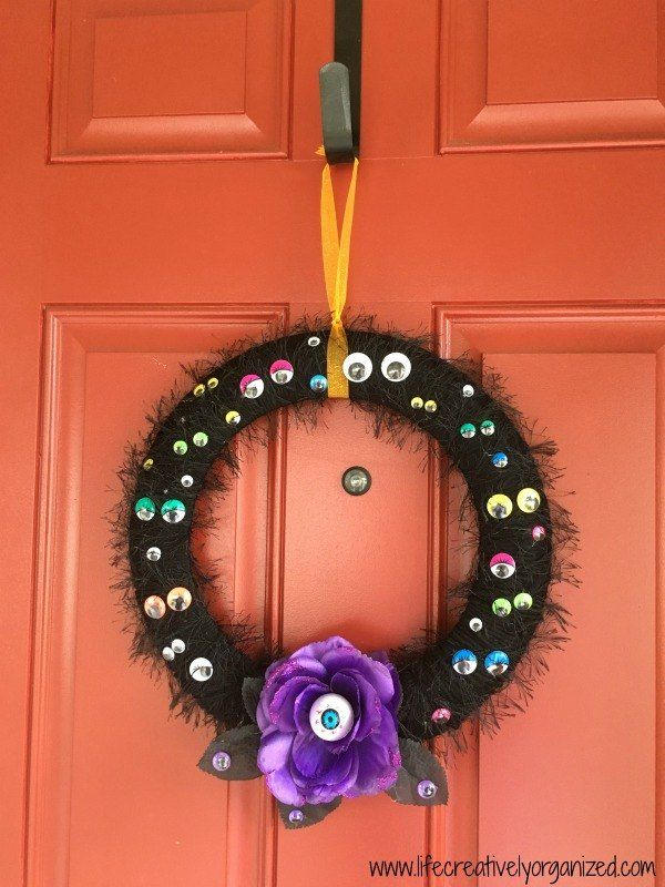 Looking for an easy and inexpensive DIY Halloween wreath that's sure to add a spooky touch to your front door?  I used 2 wire frames from the dollar store, a sk…