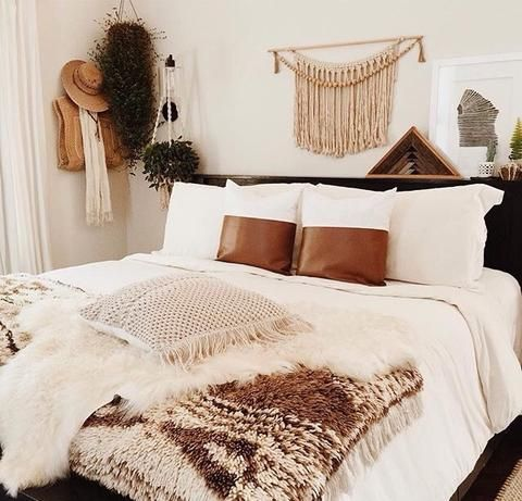 Our large and beautiful white cotton macrame decorative pillow featured in Stella Blue Gallery's beautiful boho home. Perfect for your modern home interior, boho home and decor, or nursery decor. Check the link for full product info.