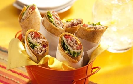 Southwestern Style Tuna Wrap.       2 pouches (2.6 oz.) StarKist Tuna Creations®, Hickory Smoked     2 flour tortillas (8-inch size)     ½ cup shredded lettuce     2 slices Pepper Jack Cheese     2 Tbsp. Ranch Dressing, reduced fat     Optional: 2 slices bacon, crumbled,  diced tomatoes add corn and black beans to this too!