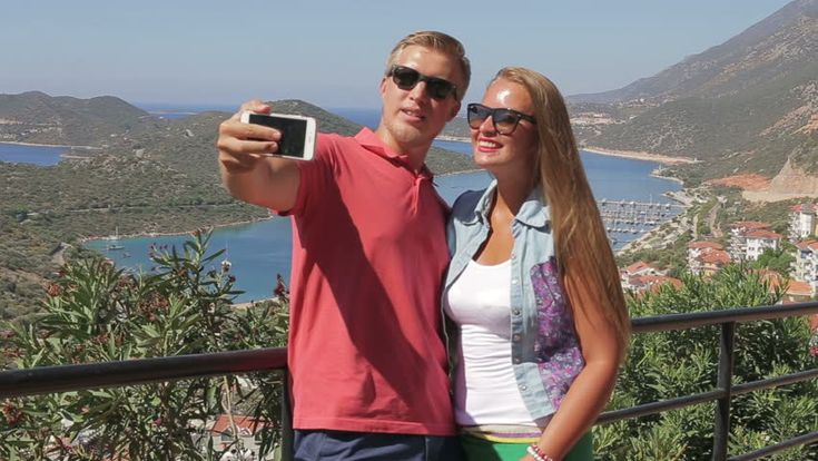 Couple Make A Photo Themselves Using Smartphone Mobile Cell Phone Camera. Стоковые футажи для видео 19908973 - Shutterstock