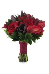 Dark red roses, dark red calla lilies, and aubergine tulips
