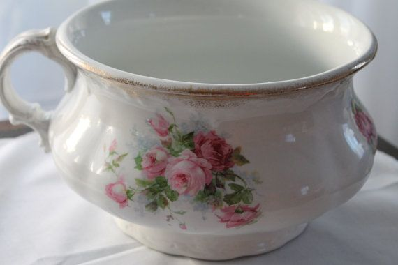 Ok, yes...its a chamber pot.  But doesn't it look like a huge teacup?  Exactly what I want to plant in outside this year.