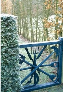 Garden gate made with old garden tools