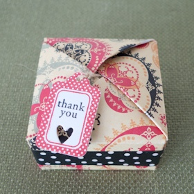 Love this cute origami gift box -- complete with tutorial!  http://jmdmoo.wordpress.com/2011/11/12/tutorial-origami-gift-box-incl-a-scor-pal-version/
