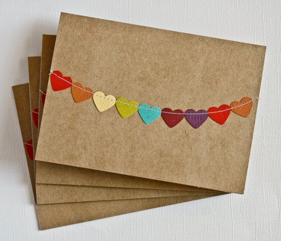 This handmade stationery set includes four handmade kraft notecards with rainbow heart bunting flag sewn across. These cards are perfect for love notes, birthday wishes and thank you cards.