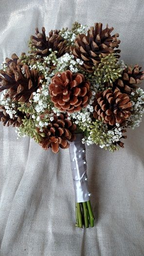 #pineconebouquet Bridesmaids bouquet with pinecones, baby's breath and naked seeded eucalyptus.