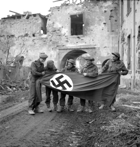 WWII Canadian soldiers with their captured flag.