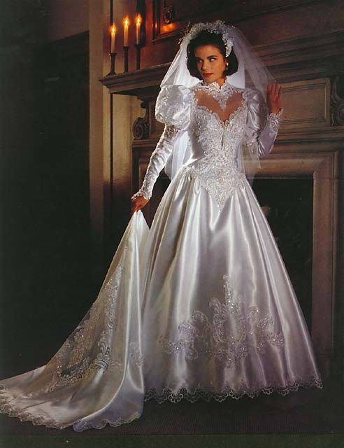 The most beautiful satin & lace ball style wedding gown I've ever seen. I have no idea where it came from but sure would love to see different views of this beautiful bridal gown. Most of all I'd love to wear it and have the fantastic figure of this model!!     Berta CD  2/6/2016  1:35 AM  EST