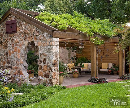 Relieved of its tin roof and doors, this old four-bay carriage house was reincarnated as an expansive 20x40-foot, open-air, outdoor living space.