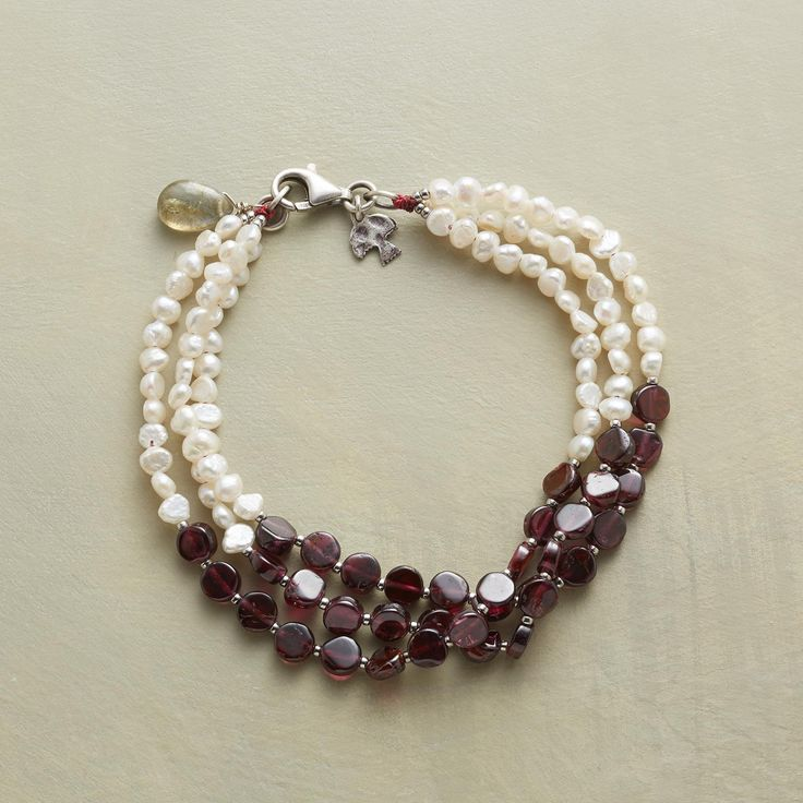 """OVER THE MOON BRACELET--Garnets lend their fiery beauty to the cool glow of pearls in a bracelet to love and cherish forever. Sterling silver. USA. Exclusive. 7-1/2""""L."""