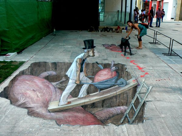 Anamorphosis is a type of art which is distorted. It is a deformed sort of an image which one has to see through the different angle to understand. Anamorphic street art is in vogue these days.