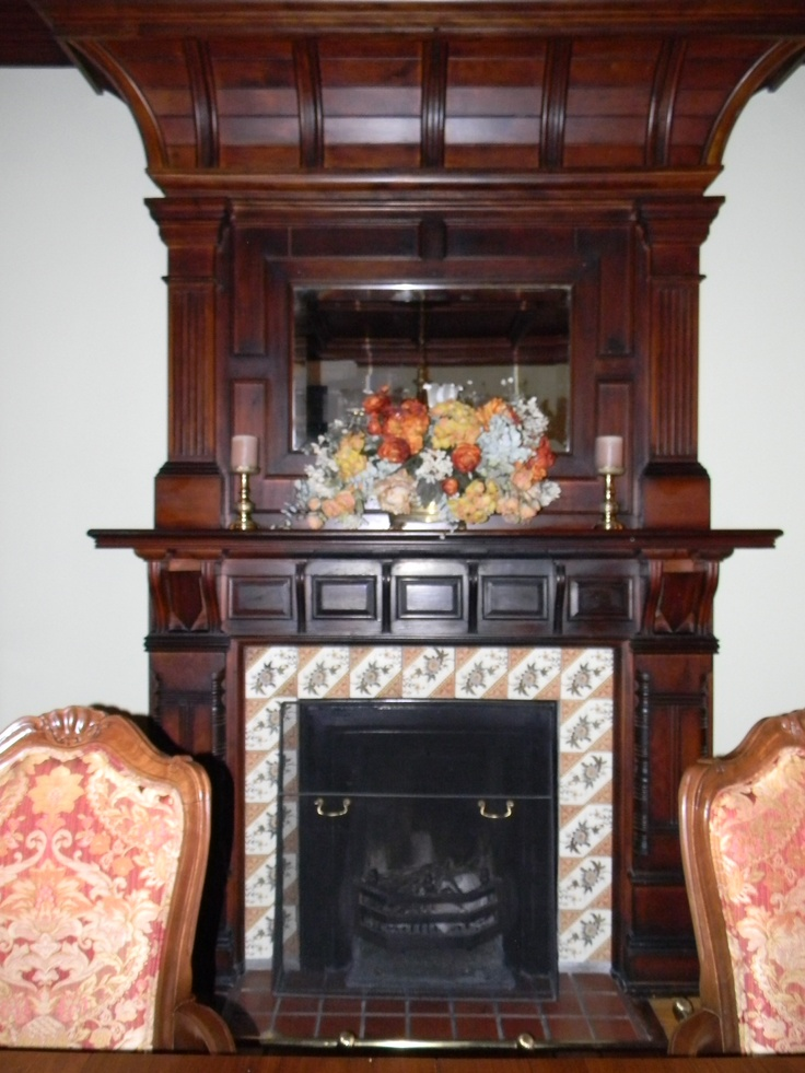 Dining room fireplace that works.. I picked up the colours in the tiles of the fireplace for the choice of my upholstery for the dining room chairs. Very pleased with the end result.