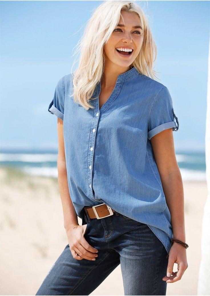 Τζιν πουκάμισο με ασύμμετρη βάση και μανίκια που διπλώνουν και σταθεροποιούνται με ζωνάκι και κουμπί. Μήκος περίπου 80 εκ. Πλένεται στο πλυντήριο. Από 100% βαμβάκι.