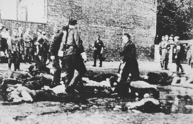 Kovno, Lithuania, June 1941, Lithuanians murdering Jews in the city square.  German soldiers watch as Lithuanians murder Jews in the city square.