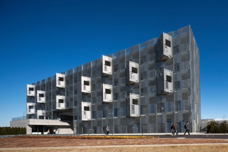 the exterior façade incorporates off-the-shelf aluminum shutter structures that create an interwoven texture and unified character.