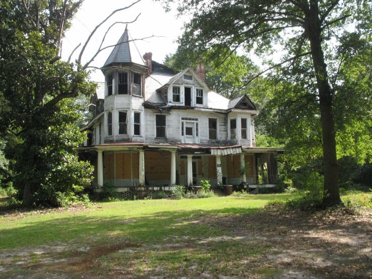 abandoned victorian with turret and wrap around porch-must have been a beauty in its day.