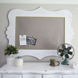 Check out this fabric corkboard. You could even customize it with colored fabric, paint or nail pins.