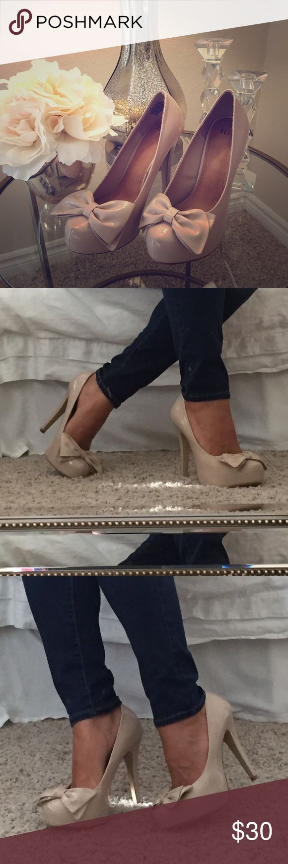 """Nude Pumps w/Bows Nude pumps by Elle; size 9; bow on each toe; inside measurement of heel is approx. 4""""; worn only for a couple hours! excellent condition, just a little dirty on the soles (see picture); cute with a dress or equally cute paired with jeans! Elle Shoes Heels"""