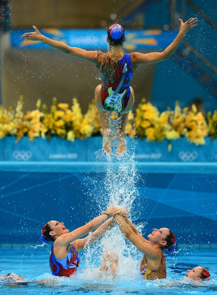 Australia's Eloise Amberger, Australia's Sarah Bombell, Australia's Olia Burtaev, Australia's Jenny-Lyn Anderson, Australia's Tamika Domrow, Australia's Bianca Hammett, Australia's Tarren Otte and Australia's Samantha Reid compete in the team free routine final during the synchronised swimming competition at the London 2012 Olympic Games on August 10, 2012 in London.