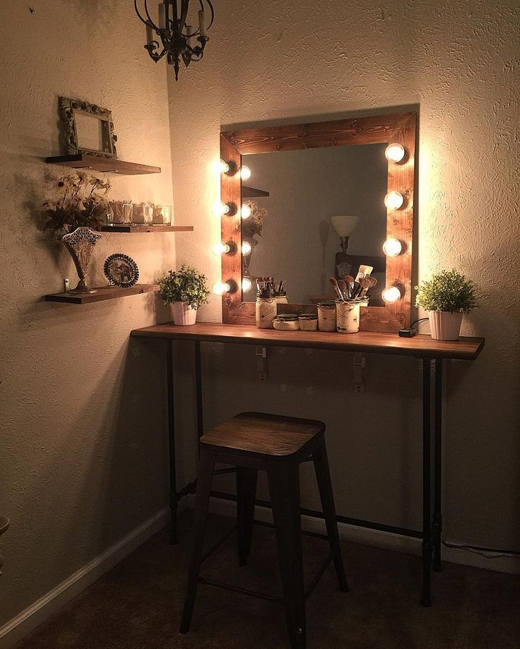 Cute easy simple DIY wood rustic vanity mirror with hollywood style lights 4 any makeup room! This cozy farmhouse style mirror is the perfect way to get a rustic-y styled makeup area, and it will help give that farm country vintage touch that can help turn a glam make up station into a custom farm house chic makeup desk / room!  I would suggest using either recycled antiqued/aged wood slats from shipping palettes or regular wood slats & warm light bulbs!