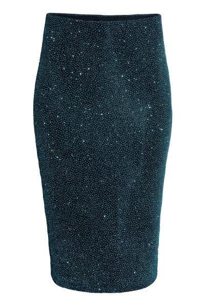 Jupe scintillante: Jupe ajustée de longueur genou en jersey avec impression scintillante. Modèle avec élastique dissimulé à la taille. Doublée jersey.