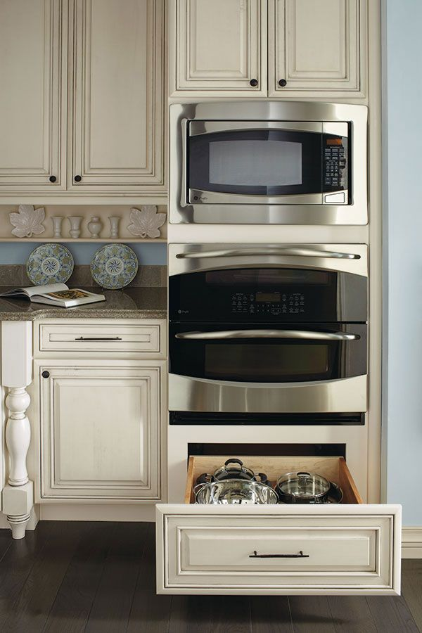 Having a deep drawer in the bottom of a double oven cabinet is perfect for storing baking items, such as Bundt and angel food cake pans or anything that needs a little extra height.