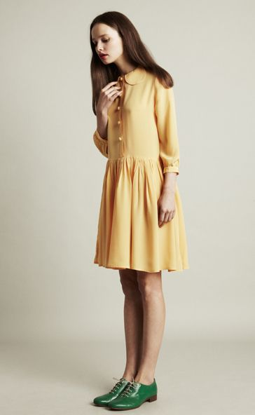 Lovely yellow dress with buttoned front, Peter Pan collar, long sleeves, cuffs and a gathered skirt. Would work well in rayon