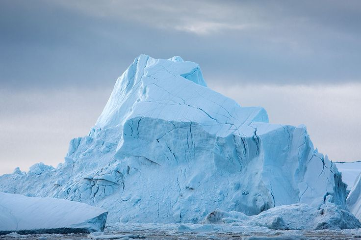 Greenland | Lawrence Hislop Photography. Blue iceberg in Ilulissat icefjord, Greenland.