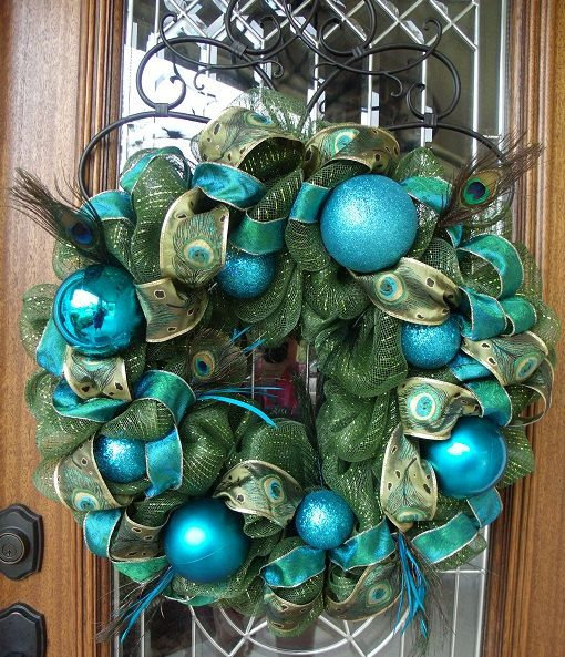 I am OBSESSED with anything that has to do with peacocks. this wreath is…