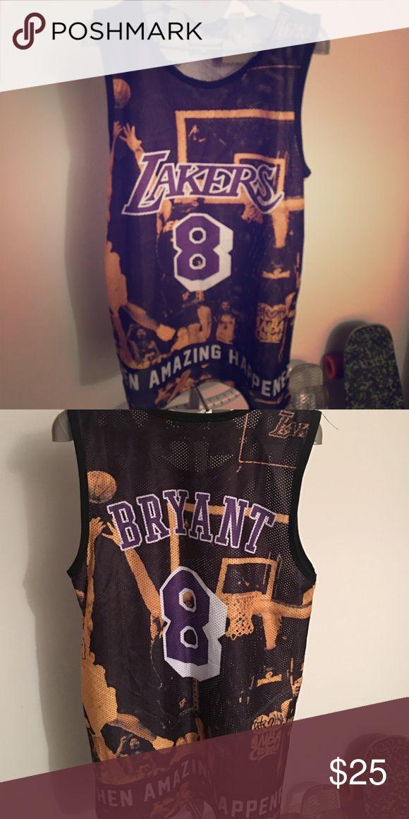 """Kobe Bryant lakers jersey Kobe lakers mesh jersey. NBA slogan """"where amazing happens"""" around bottom with Kobe number 8 and Kobe game winning shot in background never worn Shirts Tank Tops"""