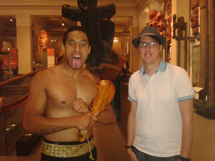 Standing in front of a Waka, with a Maori Cultural Performer . . . can't say my awkwardness quite suits the location!