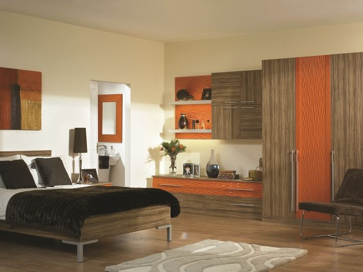 The Paprika Satin Olivewood Venice bedroom design features a stunning ripple effect in a vinyl wrapped door, which is complimented with gloss olivewood. This Venice fitted bedroom creates a contemporary look and a distinctive finish.