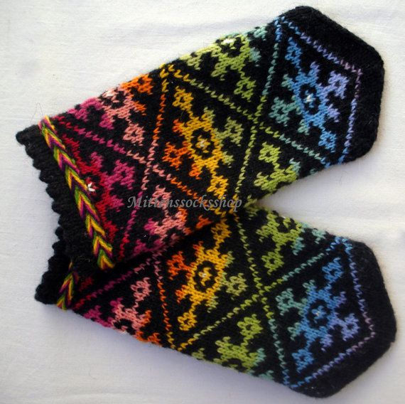 Completely original high quality hand-knittted wool mittens-colors of the rainbow tinted ornament on a black background