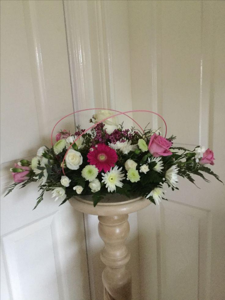 Table arrangement roses, gerbera, chrysanthemum and wax flower.