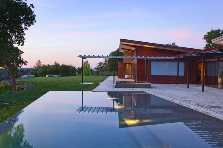 Architecture: Curved Pool With Curved Steps And Hot Tub Also Outdoor Dining Plus Outdoor Chaise Lounge Chairs And Pergola Plus Pine Trees And Pool Deck For Traditional Pool House Design