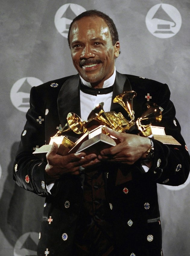Quincy Jones and some of the many Grammy Awards that he has won during his long and stellar career.