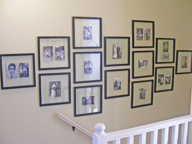 Clear glass frames, and I like this picture frame layout, 1, 2 ,3 ,2 , 3 , 2, 1 nice balance & symmetry