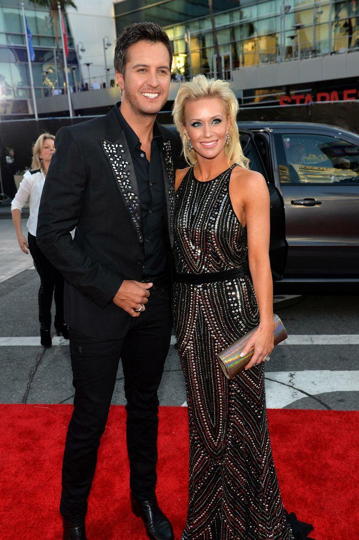 Luke Bryan and Caroline Bryan.  Gorgeous couple - but who dressed Luke in skinny pants????
